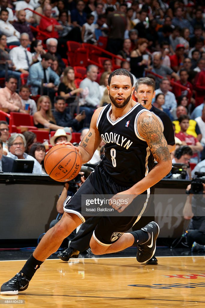 Deron Williams #8 of the Brooklyn Nets drives against the Miami Heat at the American Airlines Arena in Miami, Florida on April, 8 2014.