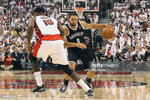 Deron Williams of the Brooklyn Nets drives against the Toronto Raptors during Game One of the Eastern Conference Quarterfinals of the 2014 NBA...