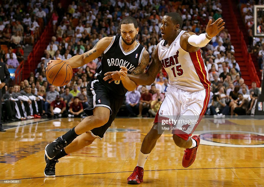 Deron Williams #8 of the Brooklyn Nets drives on Mario Chalmers #15 of the Miami Heat during a game at AmericanAirlines Arena on April 8, 2014 in Miami, Florida.