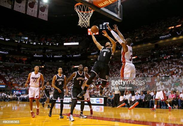 Deron Williams of the Brooklyn Nets drives past Dwyane Wade of the Miami Heat during Game Five of the Eastern Conference Semifinals of the 2014 NBA...