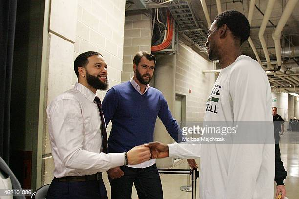 Deron Williams of the Brooklyn Nets former Utah Jazz player Mehmet Okur and Jeremy Evans of the Utah Jazz greet each other before the game on January...