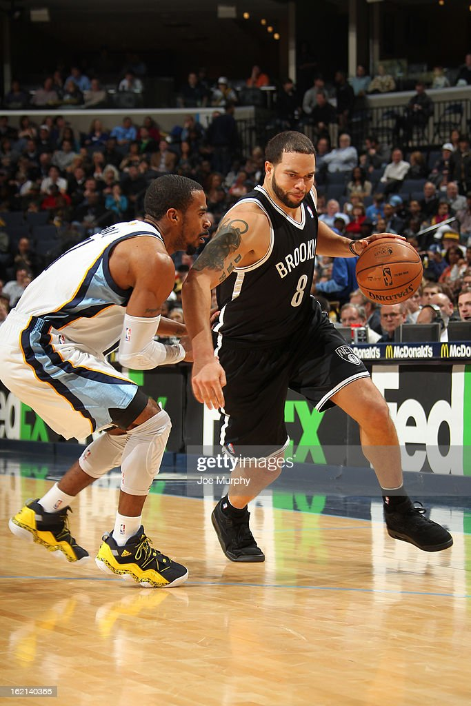 Deron Williams #8 of the Brooklyn Nets handles the ball against Mike Conley #11 of the Memphis Grizzlies on January 25, 2013 at FedExForum in Memphis, Tennessee.