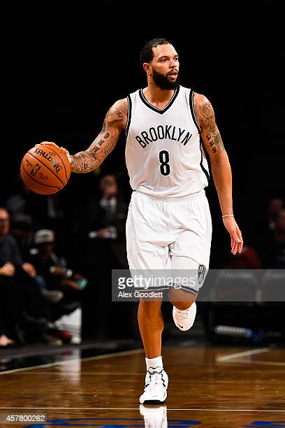 Deron Williams of the Brooklyn Nets in action during a preseason game against the Philadelphia 76ers at the Barclays Center on October 20 2014 in New...