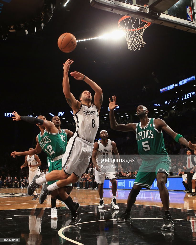 Deron Williams #8 of the Brooklyn Nets is fouled by Leandro Barbosa #12 of the Boston Celtics at the Barclays Center on November 15, 2012 in the Brooklyn borough of New York City.