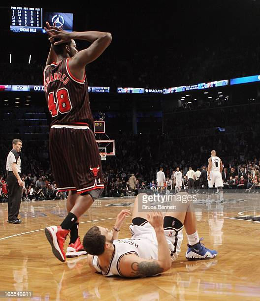 Deron Williams of the Brooklyn Nets lies on the court following a missed basket at the buzzer by Brook Lopez against the Chicago Bulls at the...