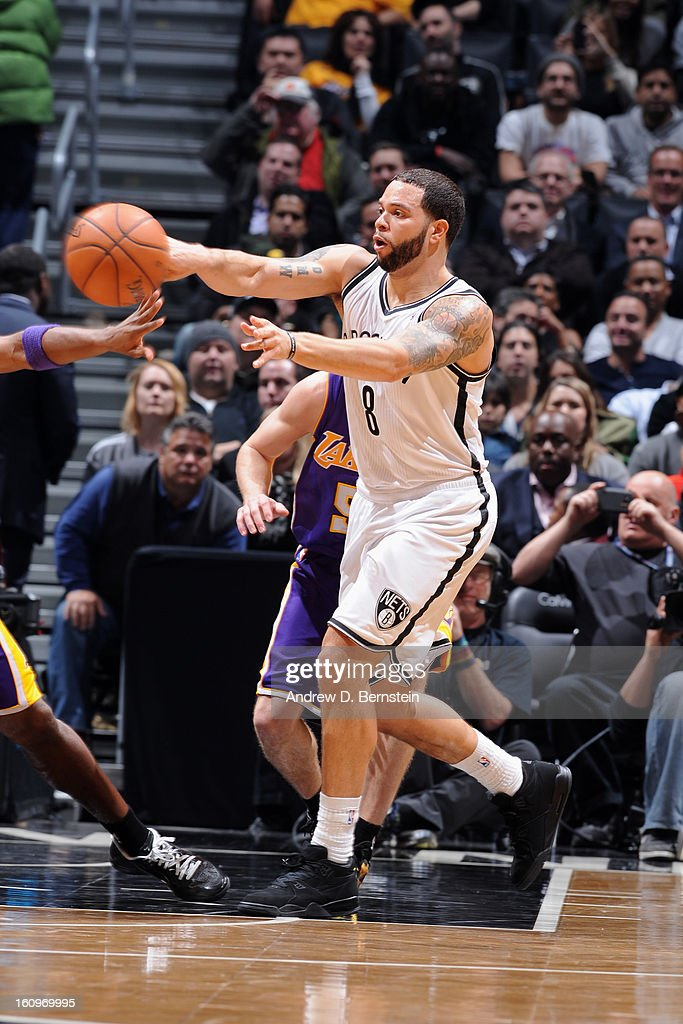 Deron Williams #8 of the Brooklyn Nets makes a pass against Los Angeles Lakers on February 5, 2013 at the Barclays Center in the Brooklyn borough of New York City.