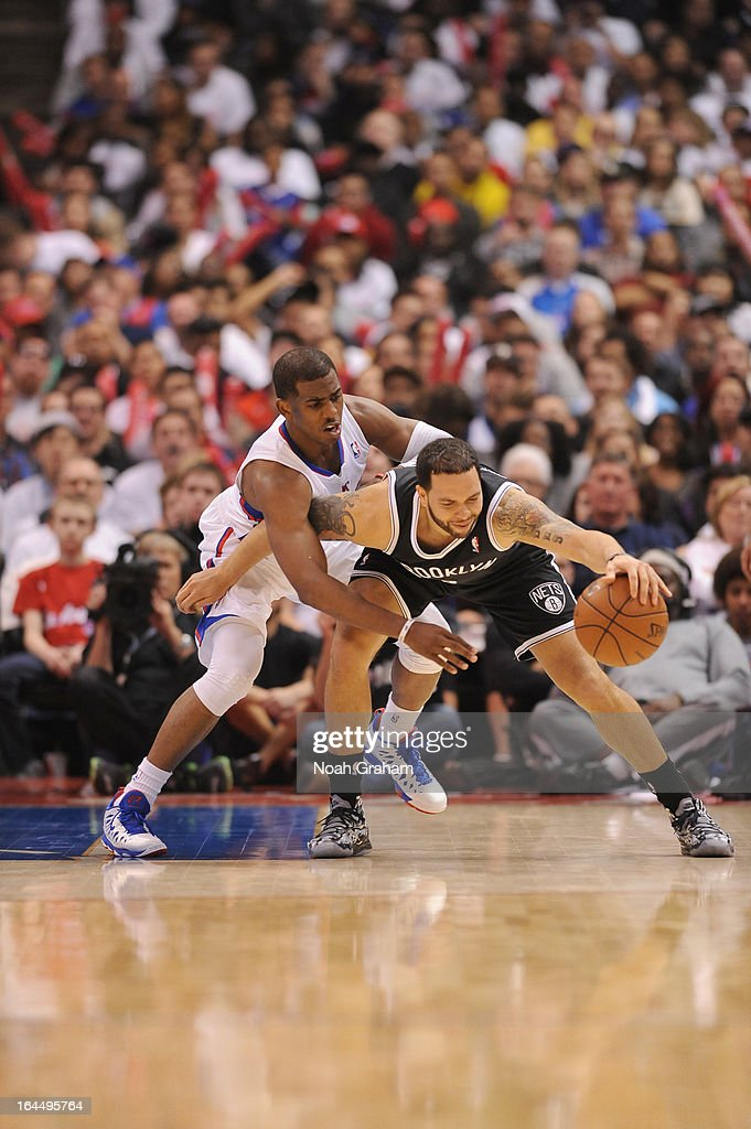 Deron Williams #8 of the Brooklyn Nets reaches for the ball against Chris Paul #3 of the Los Angeles Clippers during the game between the Los Angeles Clippers and the Brooklyn Nets at Staples Center on March 23, 2013 in Los Angeles, California.
