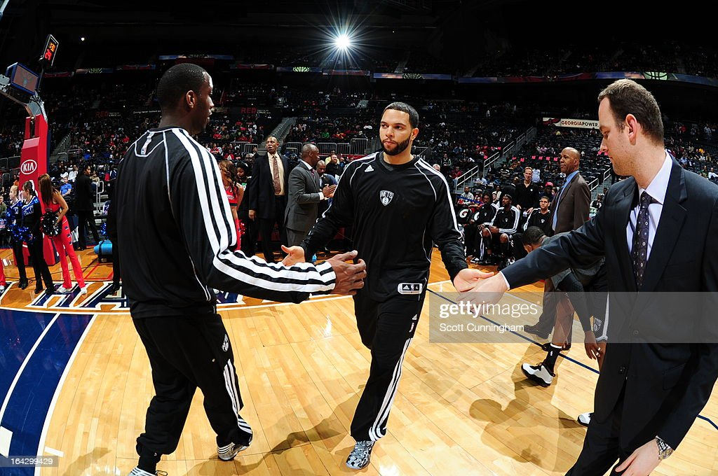 Deron Williams #8 of the Brooklyn Nets runs out before the game against the Atlanta Hawks on March 9, 2013 at Philips Arena in Atlanta, Georgia.