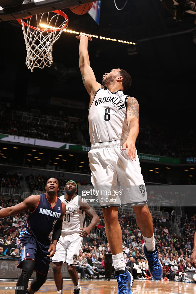 Deron Williams #8 of the Brooklyn Nets shoots a layup against the Charlotte Bobcats on April 6, 2013 at the Barclays Center in the Brooklyn borough of New York City.