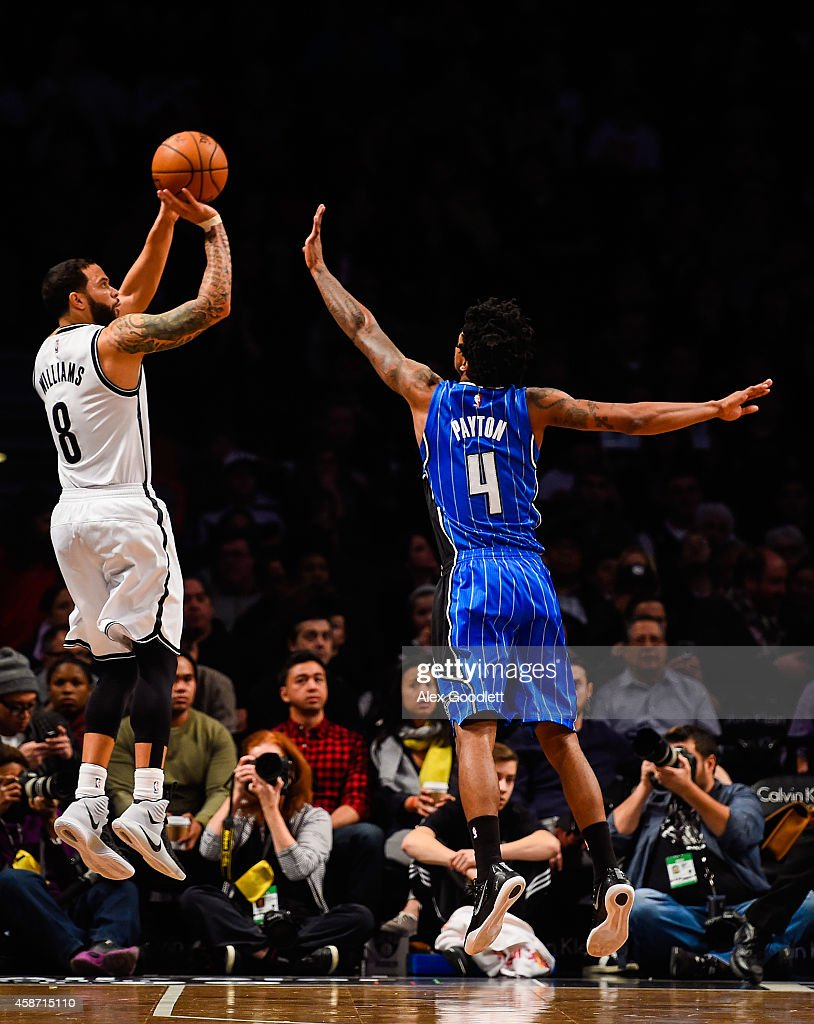 Deron Williams #8 of the Brooklyn Nets shoots over Elfrid Payton #4 of the Orlando Magic in the first half at the Barclays Center on November 9, 2014 in the Brooklyn borough of New York City.