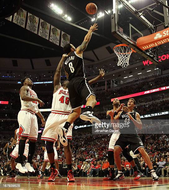 Deron Williams of the Brooklyn Nets shoots over Nazr Mohammed of the Chicago Bulls in Game Six of the Eastern Conference Quarterfinals during the...