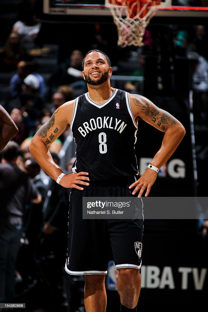 Deron Williams #8 of the Brooklyn Nets smiles while playing against the Boston Celtics during a pre-season game on October 18, 2012 at the Barclays Center in the Brooklyn borough of New York City.