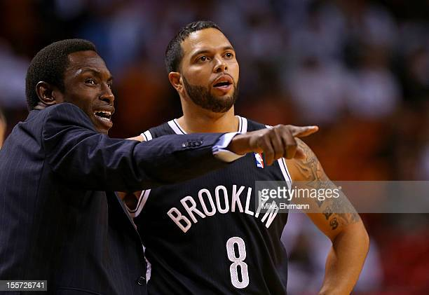 Deron Williams of the Brooklyn Nets talks with head coach Avery Johnson during a game against the Miami Heat at AmericanAirlines Arena on November 7...