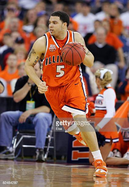 Deron Williams of the Illinois Fighting Illini drives against the Nevada Wolf Pack in the second round game of the NCAA Division I Men's Basketball...