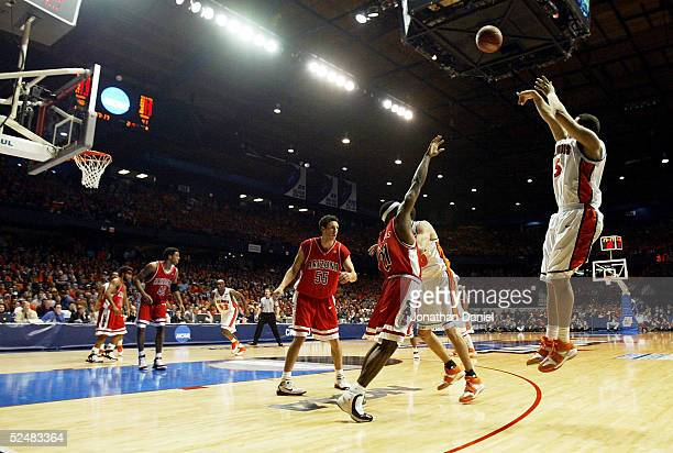 Deron Williams of the Illinois Fighting Illini shoots a three pointer late in regulation against the Arizona Wildcats in the Chicago Regional Final...