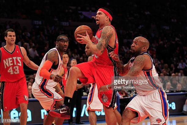 Deron Williams of the New Jersey Nets drives against Anthony Carter#25 of the New York Knicks at Madison Square Garden on March 30 2011 in New York...
