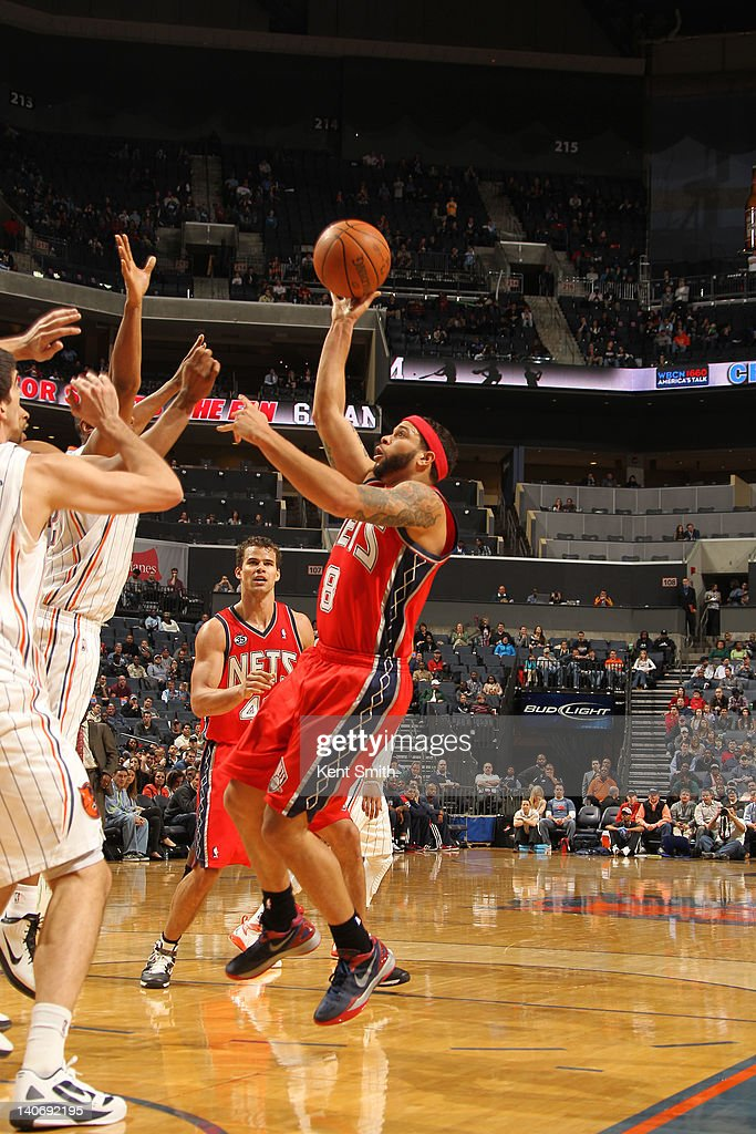 Deron Williams #8 of the New Jersey Nets shoots against the Charlotte Bobcats during the game at the Time Warner Cable Arena on March 4, 2012 in Charlotte, North Carolina.