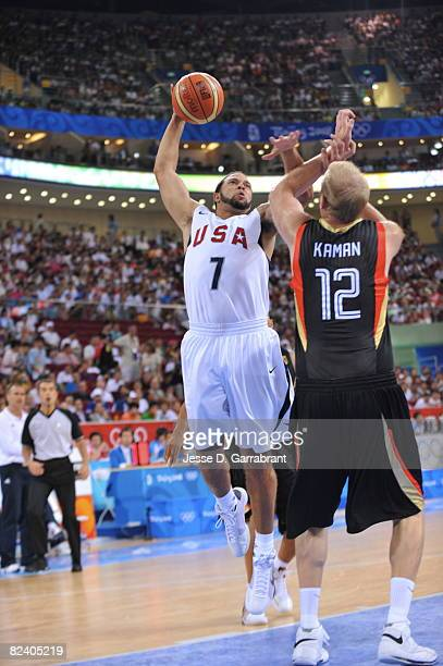 Deron Williams of the U.S. Men's Senior National Team shoots against Chris Kaman of Germany during the men's group B basketball preliminaries at the...
