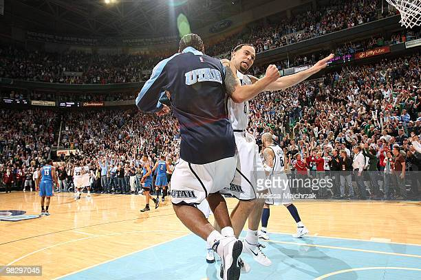 Deron Williams of the Utah Jazz celebrates with teammate Ronnie Price after defeating the Oklahoma City Thunder 140139 at EnergySolutions Arena on...