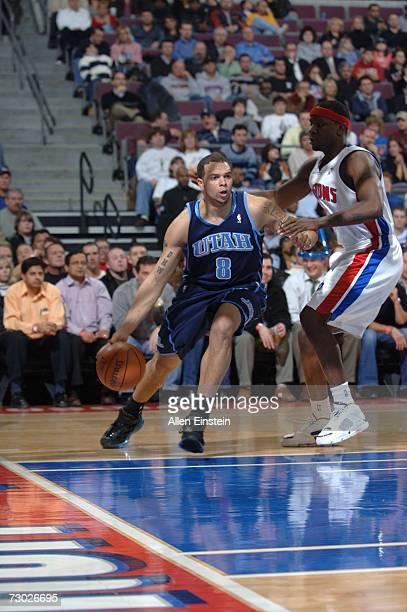 Deron Williams of the Utah Jazz drives around Flip Murray of the Detroit Pistons on January 17 2007 at the Palace of Auburn Hills in Auburn Hills...