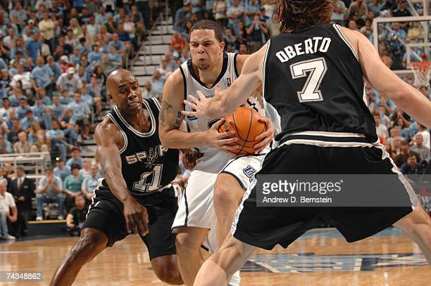 Deron Williams of the Utah Jazz drives to the hoop against Jacque Vaughn and Fabricio Oberto of the San Antonio Spurs in Game Four of the Western...