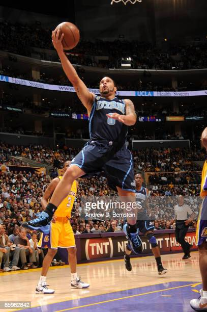 Deron Williams of the Utah Jazz goes up for a layup against the Los Angeles Lakers at Staples Center on April 14, 2009 in Los Angeles, California....