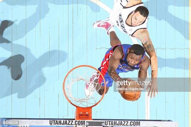 Deron Williams of the Utah Jazz goes up to block Will Bynum of the Detroit Pistons at EnergySolutions Arena on November 21 2009 in Salt Lake City...