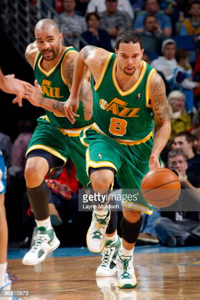 Deron Williams of the Utah Jazz is trailed by teammate Carlos Boozer as they take on the New Orleans Hornets on February 17 2010 at the New Orleans...