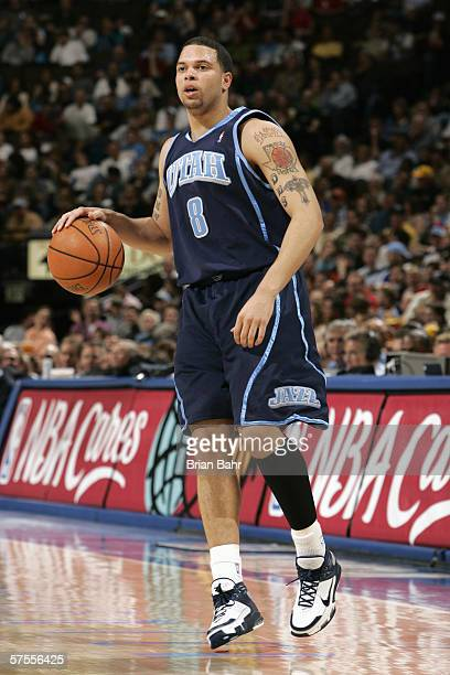 Deron Williams of the Utah Jazz looks to move the ball during the NBA game against the Denver Nuggets on March 29 2006 at the Pepsi Center in Denver...
