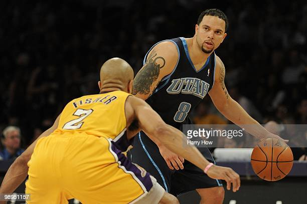 Deron Williams of the Utah Jazz moves the ball against Derek Fisher of the Los Angeles Lakers during Game Two of the Western Conference Semifinals...