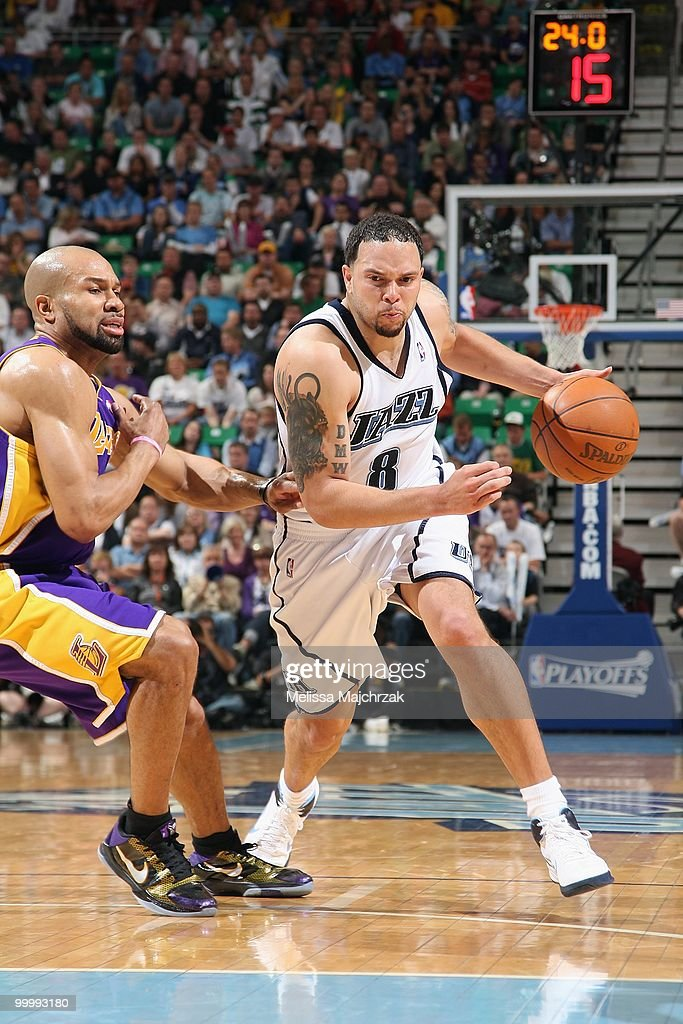 Deron Williams #8 of the Utah Jazz moves the ball against Derek Fisher #2 of the Los Angeles Lakers in Game Four of the Western Conference Semifinals during the 2010 NBA Playoffs at the EnergySolutions Arena on May 10, 2010 in Salt Lake City, Utah. The Lakers won 111-96.