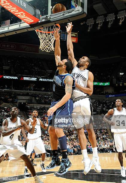 Deron Williams of the Utah Jazz shoots against Malik Hairston of the San Antonio Spurs on November 19 2009 at the ATT Center in San Antonio Texas...