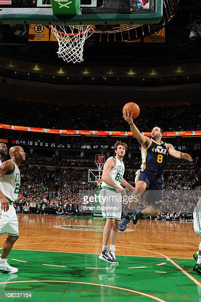 Deron Williams of the Utah Jazz shoots against Ray Allen of the Boston Celtics during the game on January 21 2011 at the TD Garden in Boston...
