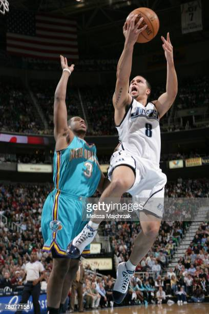 Deron Williams of the Utah Jazz shoots over Chris Paul of the New Orleans Hornets on November 23, 2007 at the EnergySolutions Arena in Salt Lake...