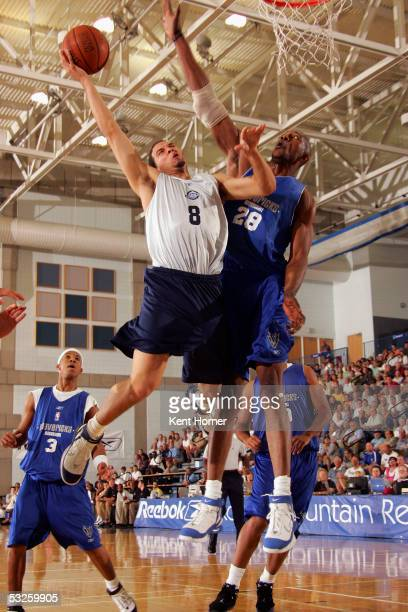 Deron Williams of the Utah Jazz shoots the ball against DJ Mbenga of the Dallas Mavericks on July 19 2005 at the Reebok Rocky Mountain Revue in Salt...