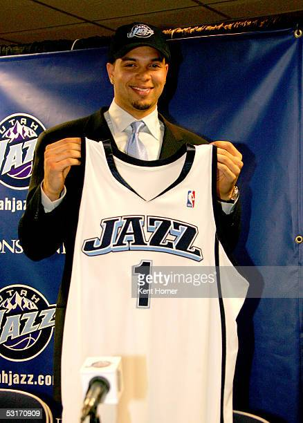 Deron Williams third pick in the NBA draft by the Utah Jazz holds up a jersey at a news conference June 29 2005 at the Delta Center in Salt Lake City...