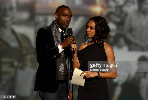 Derreck Kayongo and show host Nischelle Turner speak onstage during the CNN Heroes An All Star Tribute at The Shrine Auditorium on December 2 2012 in...