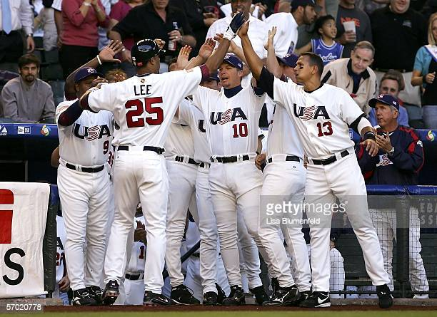 Derrek Lee of Team USA is congratulated by teammates Chipper Jones and Alex Rodriguez after hitting a solo home run against Team Mexico during the...
