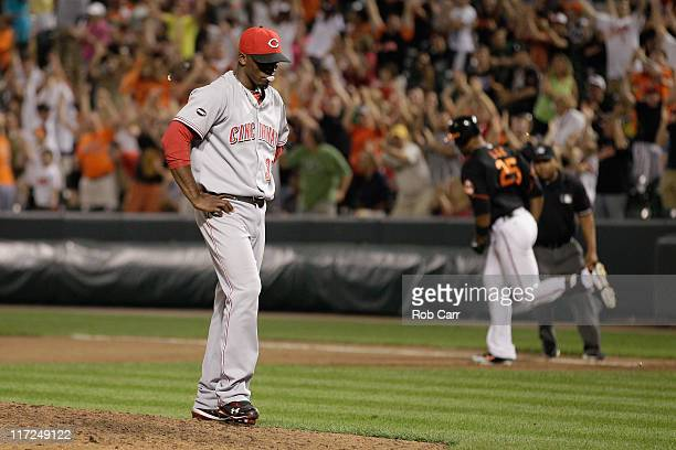 Derrek Lee of the Baltimore Orioles rounds the bases after hitting a walk off home run off of pitcher Jose Arredondo of the Cincinnati Reds to win...
