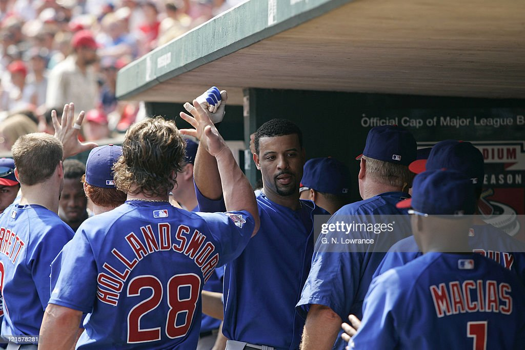 Derrek Lee of the Chicago Cubs is congratulated after hitting a home run during a game against the St. Louis Cardinals at Busch Stadium in St. Louis, Mo. on July 23, 2005. The Cubs won 6-5.