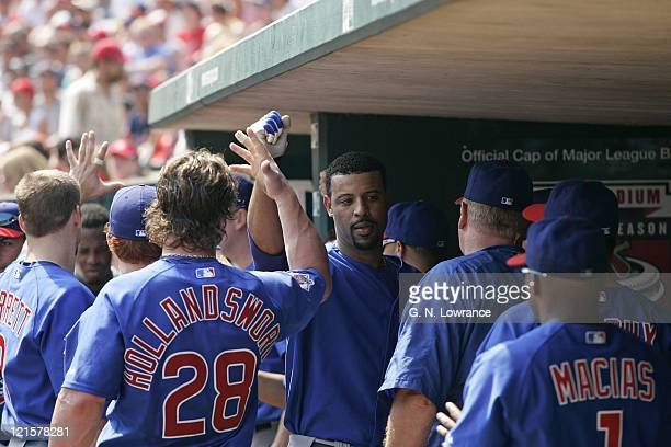 Derrek Lee of the Chicago Cubs is congratulated after hitting a home run during a game against the St Louis Cardinals at Busch Stadium in St Louis Mo...
