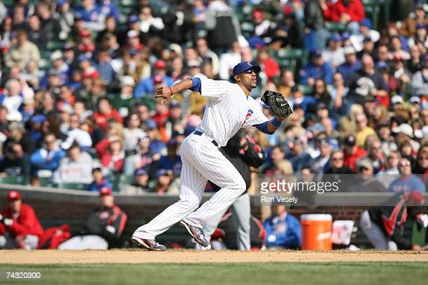 Derrek Lee of the Chicago Cubs runs after a pop fly during the game against the Cincinnati Reds at Wrigley Field in Chicago Illinois on April 13 2007...