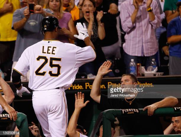 Derrek Lee of the Pittsburgh Pirates is congratulated by teammate Chris Snyder after he hit a two run home run in the 8th inning against the Chicago...