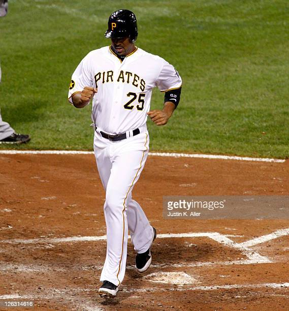 Derrek Lee of the Pittsburgh Pirates touches home after a sacrifice fly by Ryan Ludwick against the Cincinnati Reds during the game on September 24...