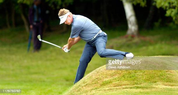 Derren Clarke plays his 2nd shot from an awkward lay on the 8th hole during the Voilvo PGA golf champioship at Wentworth GC in England 29th May 2004.
