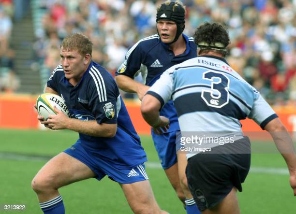 Derren Witcombe with ball followed by Daniel Braid of the Blues during the Super 12 match between the Auckland Blues and the NSW Waratahs at Eden...