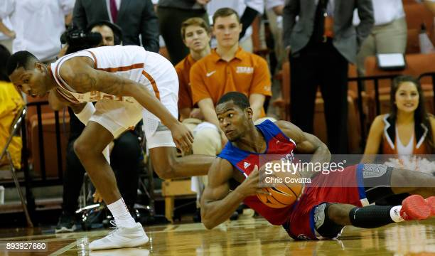 Derric Jean of the Louisiana Tech Bulldogs looks to pass the ball as Kerwin Roach II of the Texas Longhorns defends him at the Frank Erwin Center on...