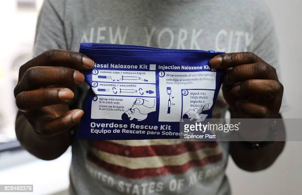 Derrick a participant in a class on opioid overdose prevention held by nonprofit Positive Health Project holds up an overdose rescue kit after...