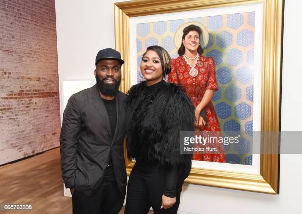 Derrick Adams and Jazmine Sullivan attend HBO's The HeLa Project Exhibit For The Immortal Life of Henrietta Lacks on April 6 2017 in New York City