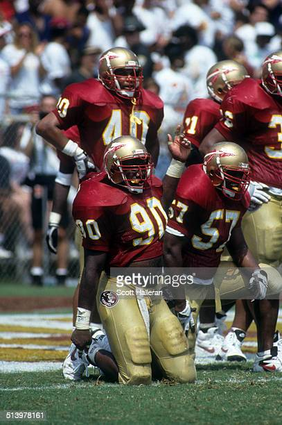 Derrick Alexander John Nance and Alonzo Horner of the Florida State Seminoles rest on the field during an NCAA game against the Clemson Tigers on...